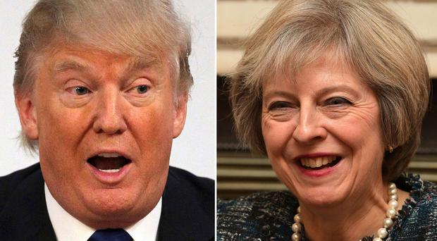 Scientists are calling on Theresa May to attempt to persuade Donald Trump to take the threat of climate change seriously