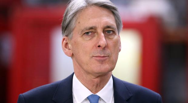 Chancellor Philip Hammond said 'action will be required' to return the public finances to balance
