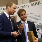 The Duke of Cambridge (left) and Prince Harry (centre) talk with Alan Robinson as they attend the inaugural Endeavour Fund Awards ceremony at the Royal Geographical Society in London.