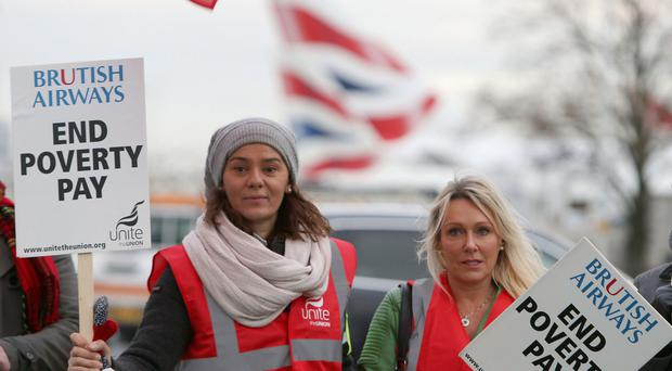 British Airways cabin crew members will strike in a row over pay