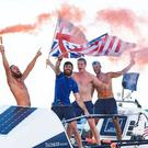 The crew celebrate their record-breaking achievement