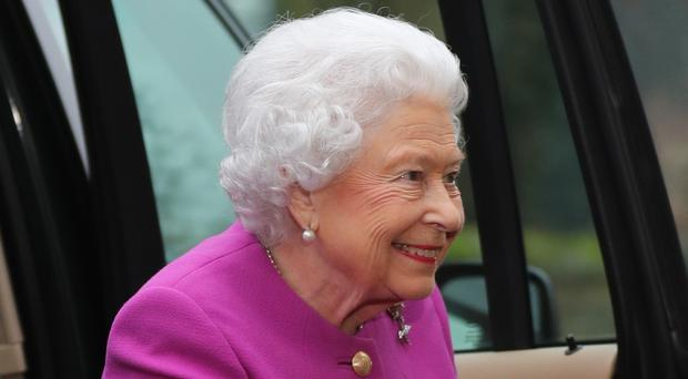 The Queen arrives at West Newton village hall in Norfolk