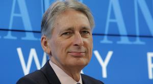 Chancellor Philip Hammond said at Davos that Britain has reinvented itself before and will do again if it is closed off from EU markets (AP/Michel Euler)