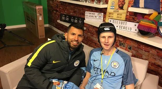 Former Manchester City ball boy Elliott Fernandez with his hero Sergio Aguero