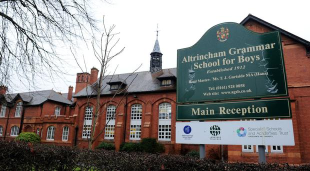 The head of Altrincham Grammar School for Boys is considering asking parents for hundreds of pounds a year in voluntary contributions