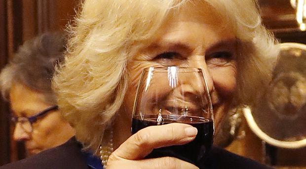 The Duchess of Cornwall toasts with a glass of wine after she was installed as a liveryman of The Worshipful Company of Vintners in London