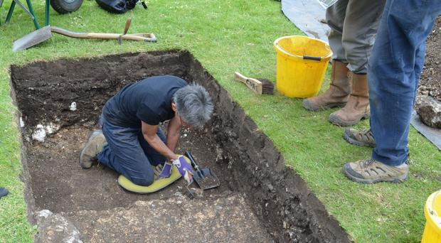 Archaeologists during a dig in Priory Park, Chichester, West Sussex (Chichester District Council/PA)