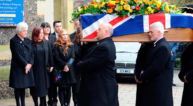 Graham Taylor's family watch as the coffin is taken into the church