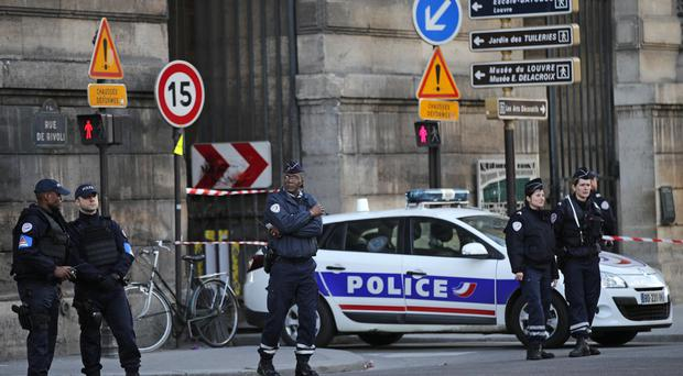 Police officers cordon off the area outside the Louvre in Paris after a soldier opened fire when he was attacked (AP Photo/Christophe Ena)