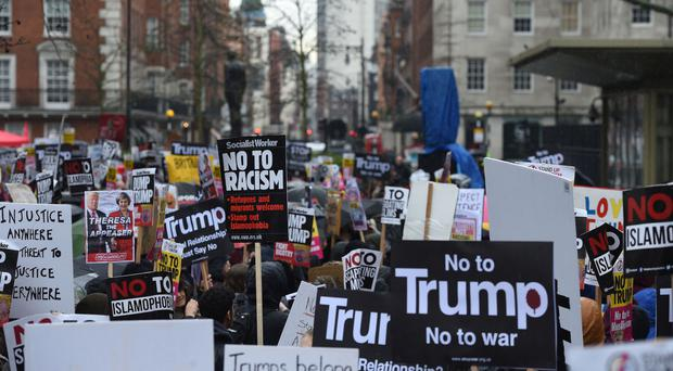 Demonstrators gather at the US Embassy in central London, ahead of a protest and march to Downing Street, against US President Donald Trump's travel ban