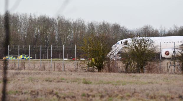 A Pakistan International Airlines plane at Stansted Airport after being intercepted by the RAF