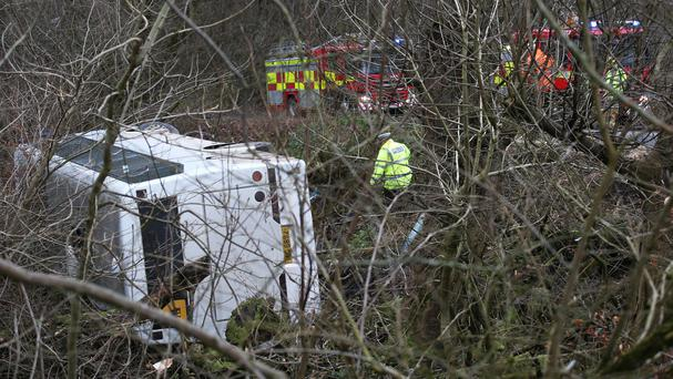 Bus carrying Scots pupils overturns and crashes into woods near high school