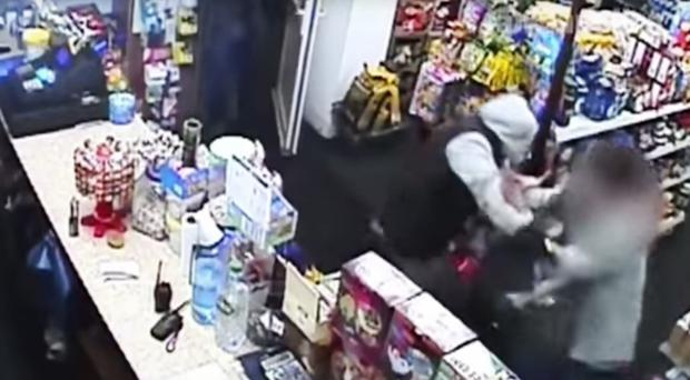 CCTV still of a shopkeeper who foiled a robbery by blasting a gunman in the face with a repellent spray (West Midlands Police/PA)