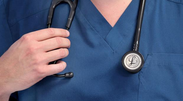 File photo of a doctor holding a stethoscope, as it is confirmed the NHS in England is performing at its worst ever level against a raft of targets