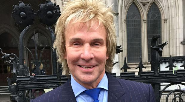 Pimlico Plumbers owner Charlie Mullins outside the Royal Courts of Justice in London