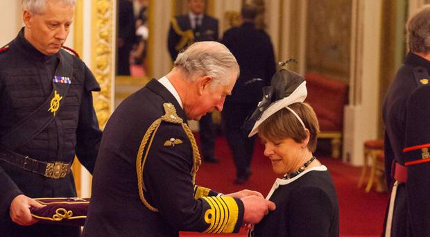 Caroline Spelman is made a Dame Commander of the British Empire by the Prince of Wales
