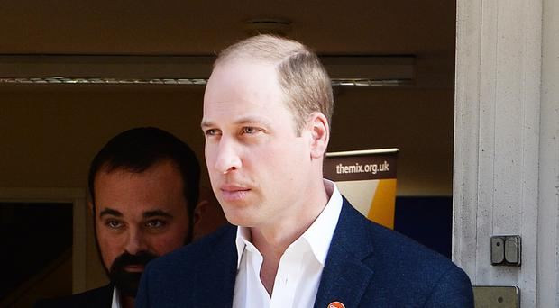 The Duke of Cambridge leaves The Mix in London where he launched the Centrepoint helpline