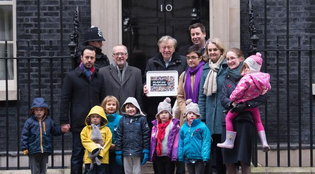 Lord Dubs, religious and community leaders and foster carers handed in a petition urging Theresa May to reconsider the decision to close the Dubs scheme for vulnerable unaccompanied refugee children in Europe