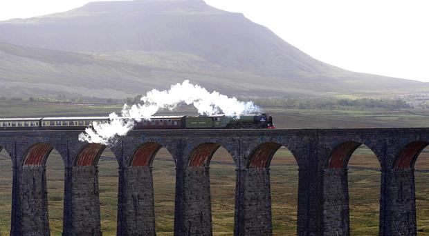 The Tornado travels over the Ribblehead Viaduct