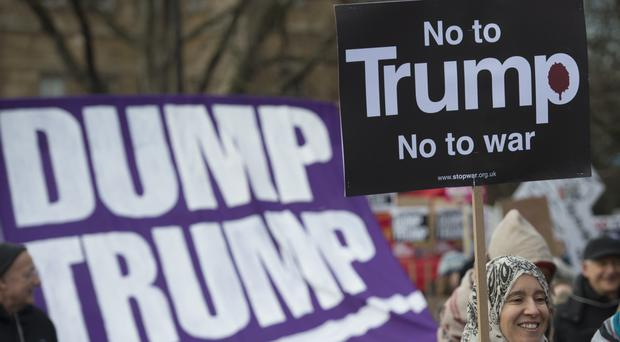 Demonstrators march to Downing Street in a protest against US President Donald Trump's travel ban