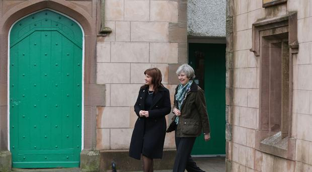 Prime Minister Theresa May (right) and Conservative Party candidate for the Copeland by-election, Trudy Harrison