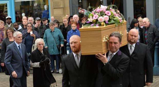 The coffin of 'Allo 'Allo star Gorden Kaye is carried into Huddersfield Parish Church for his funeral service
