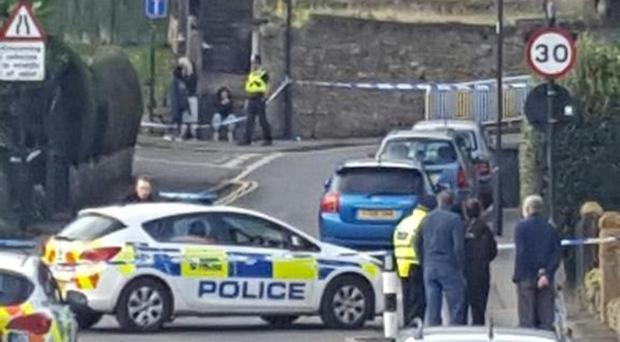 Armed police have sealed off a Sheffield street following a shooting.