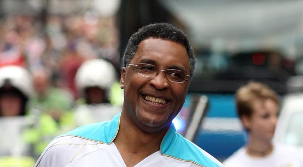 File photo dated 29/8/2012 of Michael Watson carrying the Paralympic Flame. The former boxer was left injured after a suspected rush-hour car-jacking attempt, a spokesman for the ex-sportsman said.