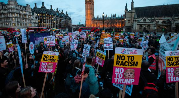 Protesters taking part in a rally in Parliament Square against US president Donald Trump's state visit to the UK