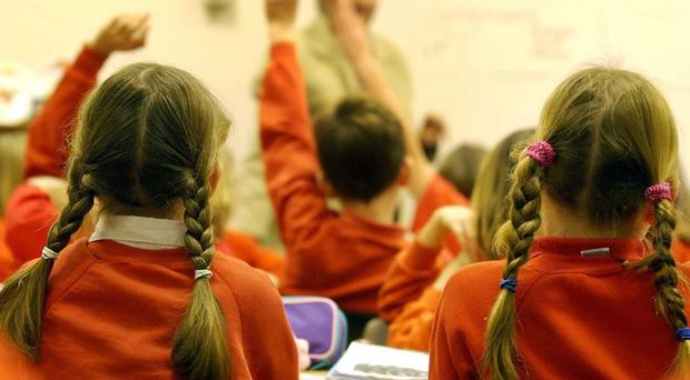 A report calls for urgent new focus on retaining teachers and suggested a cap on the number of their hours