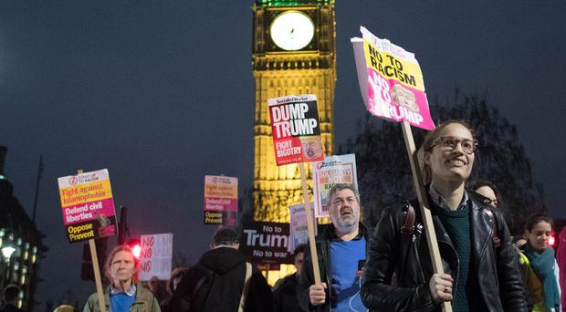 Demonstrators attend a rally in Westminster protesting against Donald Trump