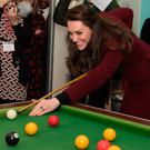 The Duchess of Cambridge shows of her lacklustre pool skills during her visit to MIST yesterday