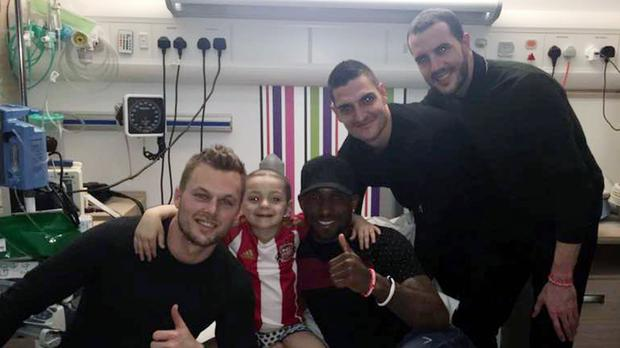 Handout photo taken from the Facebook page of Bradley Lowery Fight Against Neuroblastoma, of Bradley Lowery meeting Sunderland footballers Seb Larsson, Jermain Defoe, Vito Mannone and John O'Shea