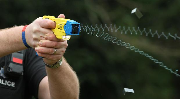 A blind man has been Tasered by police after his cane was mistaken for a gun.