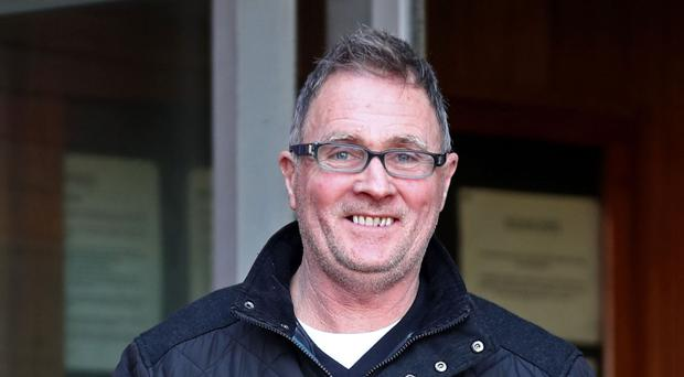 Nigel Ingram leaves Margate Magistrates Court in Kent who along with John Blight face charges in connection with the alleged removal of items from a wrecked Royal Navy warship in the English Channel.