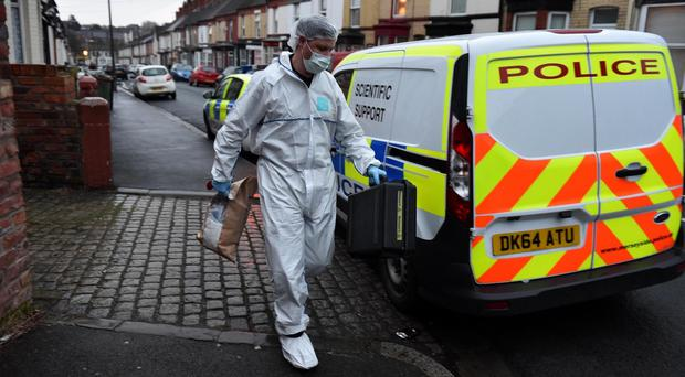 Forensic officers at a house in Birkenhead after the death of the two-year-old boy