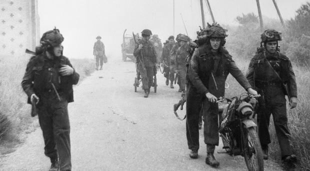 Royal Marines from 48 Commando prepare to push out of the beachhead after landing close to the resort of St Aubin sur Mer