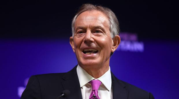 Tony Blair has dismissed a report he is in talks to become an adviser to US President Donald Trump as