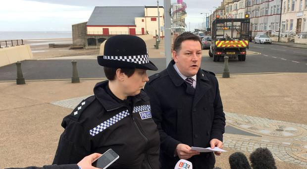 Detective Chief Inspector Steve Young and Chief Inspector Emily Harrison speak to the media on Redcar promenade where a woman and her child were snatched on Friday