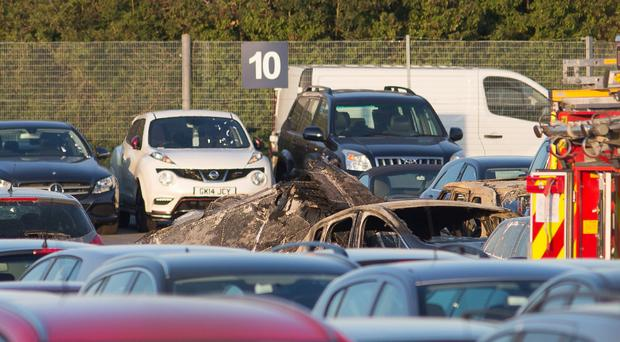 The aftermath of the crash which killed four people at Blackbushe Airport in Hampshire in July 2015