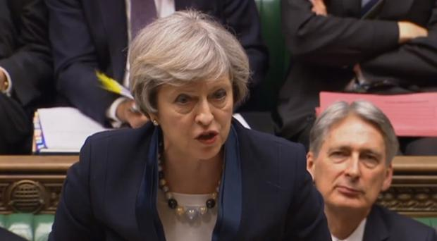 Theresa May speaks during Prime Minister's Questions in the House of Commons