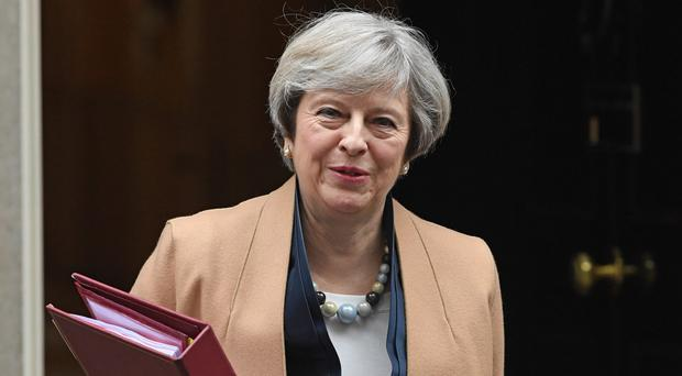 Prime Minister Theresa May has defended Budget measures that increase National Insurance payments for some self-employed workers