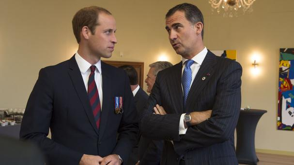 The Duke of Cambridge with King Felipe VI of Spain, who will visit the UK in June (Belgium government/PA)