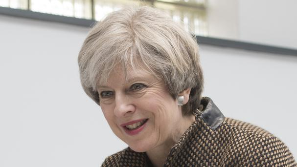 Documents revealing Prime Minister Theresa May's travel plans were found on a train.