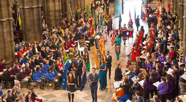 Flag bearers carry the flags of the commonwealth nations during the Commonwealth Service at Westminster Abbey, London (Dominic Lipinski/PA)