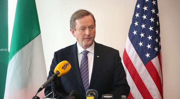 Enda Kenny speaking to journalists at his hotel in Washington