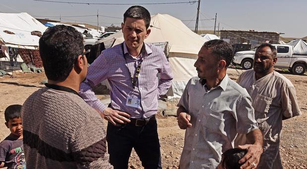 David Miliband meeting refugees in Iraq recently (International Rescue Committee UK/PA Wire)