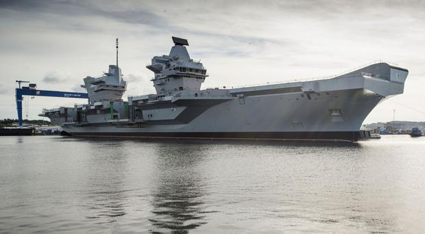 The first of the ships - HMS Queen Elizabeth - is nearing completion and due to make its inaugural sailing this summer, the National Audit Office said