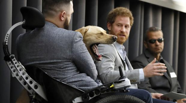 Prince Harry leads a discussion with former armed forces members at the Veterans' Mental Health Conference in London