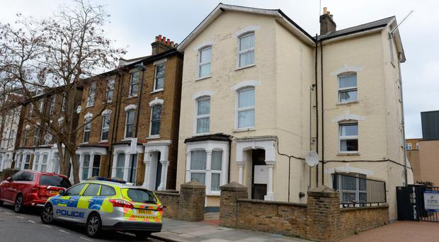 Police at the flat in Wilberforce Road, north London where a boy was found fatally injured. Last night Bidhya Sagar Das was arrested by officers in the Hackney area and is in custody